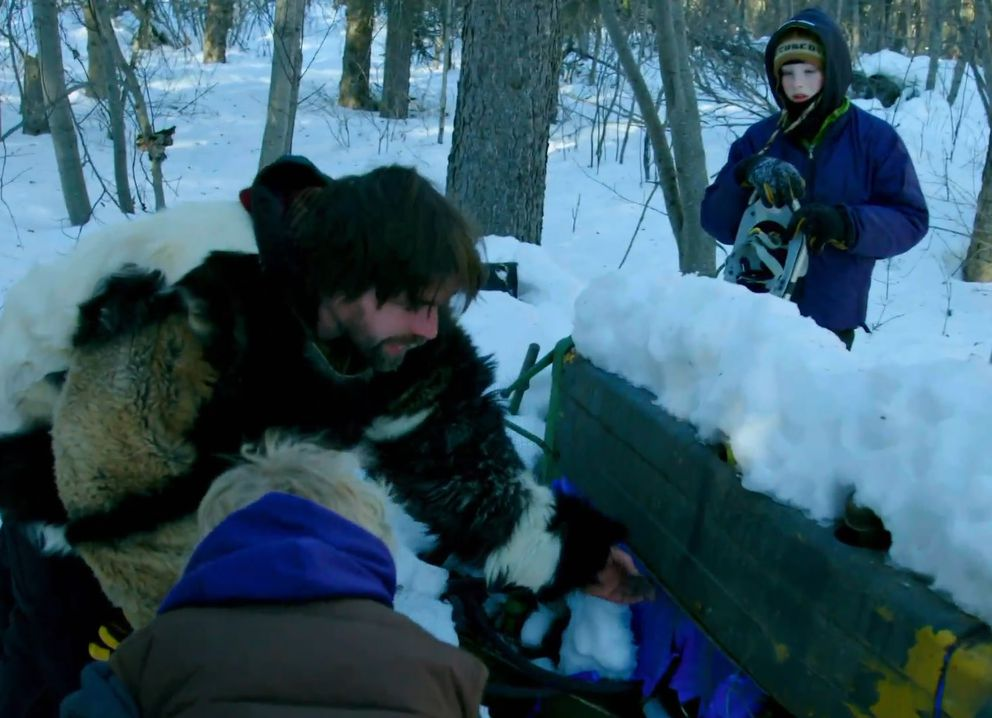 Jeremy Keller and his children deploy snowshoes to dig out an old bulldozer near McCarthy. (Screen capture via Discover)