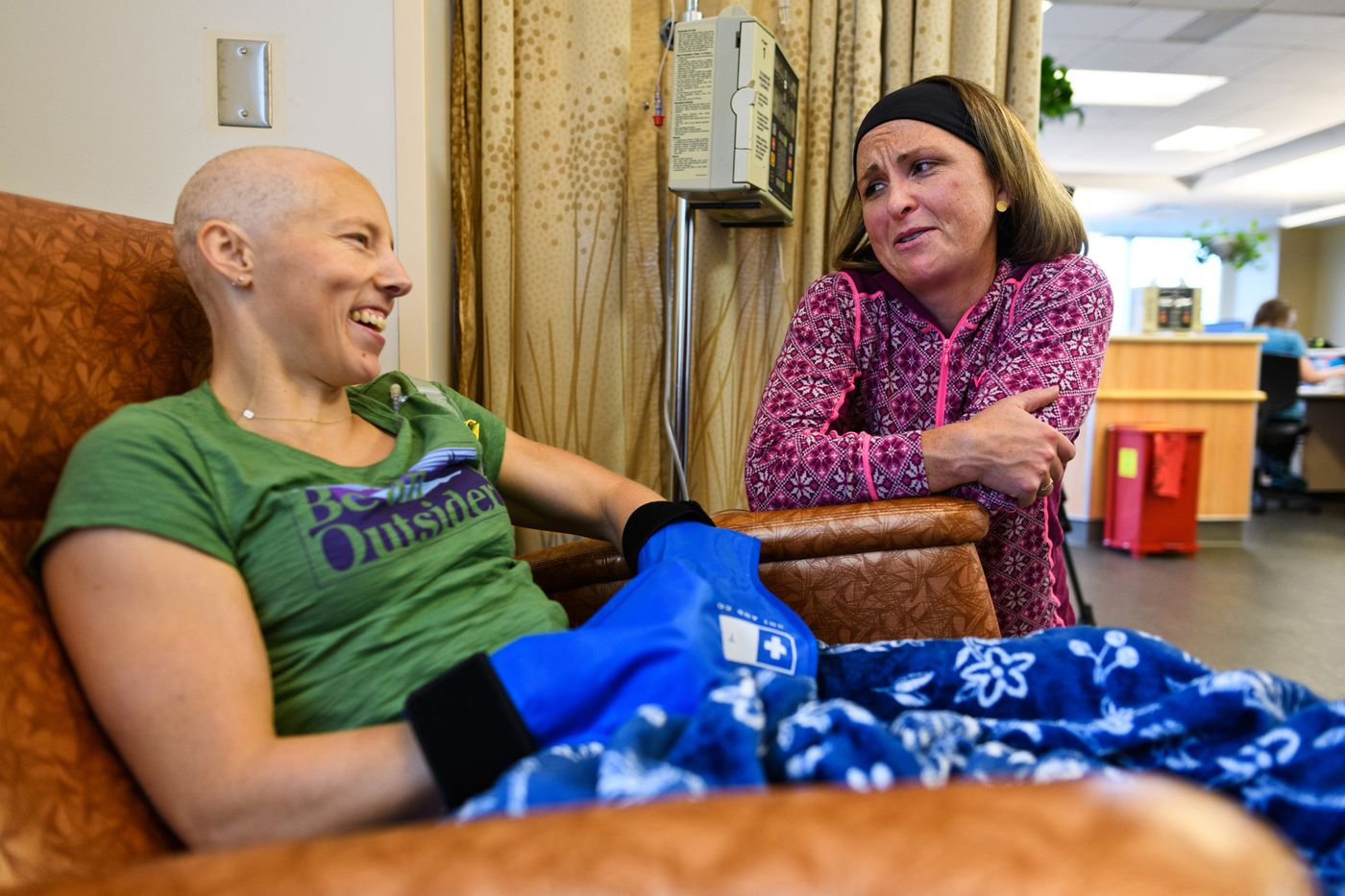 Former Team USA teammate Holly Brooks, right, visits with Kikkan Randall during a chemotherapy treatment at Katmai Oncology Group on August 21, 2018. (Marc Lester / ADN)