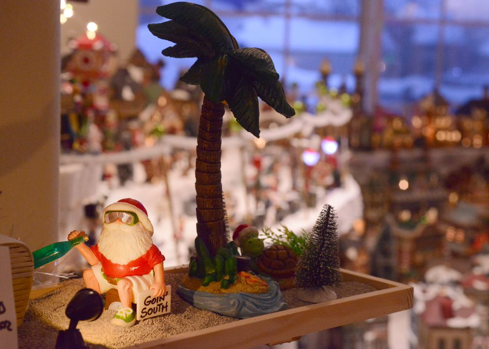 Santa relaxes in a southern climate in one section of Nate Baer's Christmas village. (Anne Raup / ADN)
