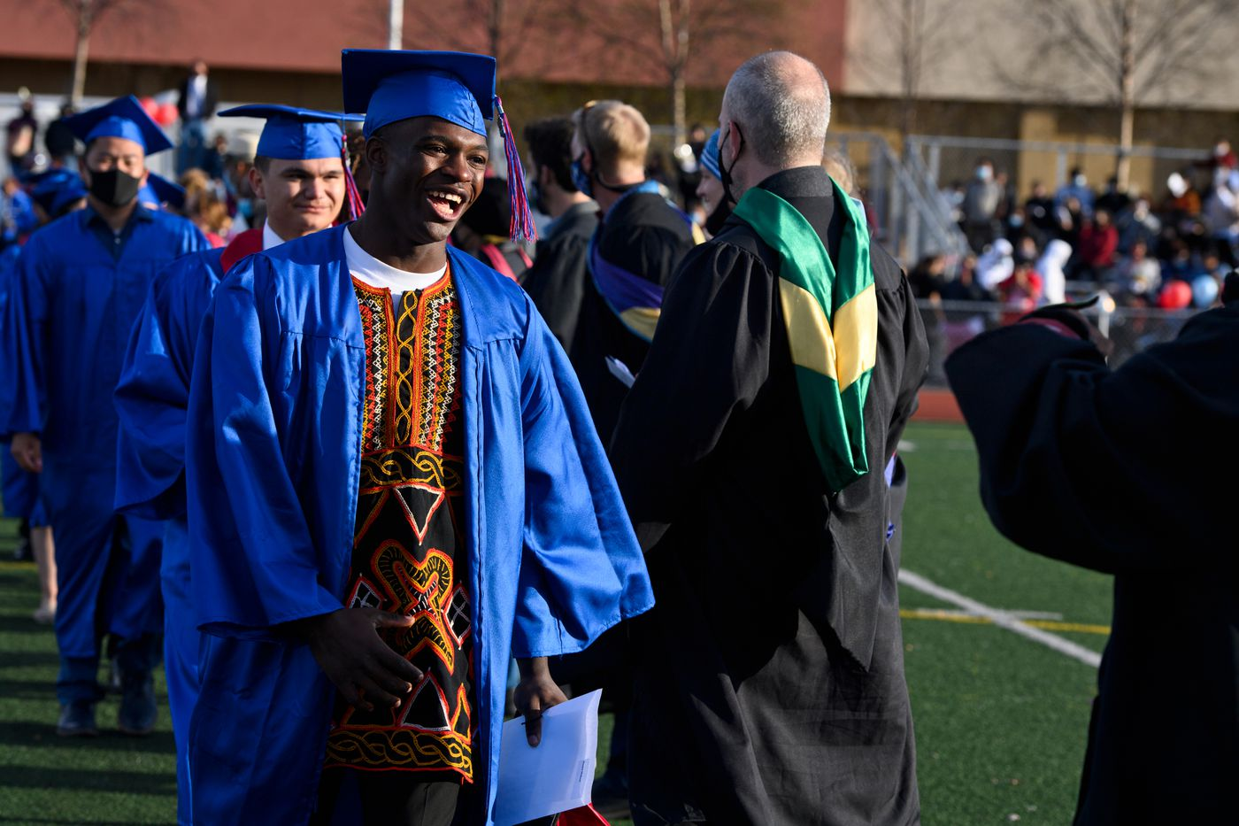 Daniel Mokom wore an embroidered shirt traditional to to Camaroon at his East High School graduation. (Marc Lester / ADN)