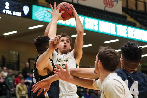 UAA's Sjur Berg catches a rebound during a game against Concordia on Saturday, Jan. 5, 2019 at the Alaska Airlines Center. UAA won 75-66. (Loren Holmes / ADN)