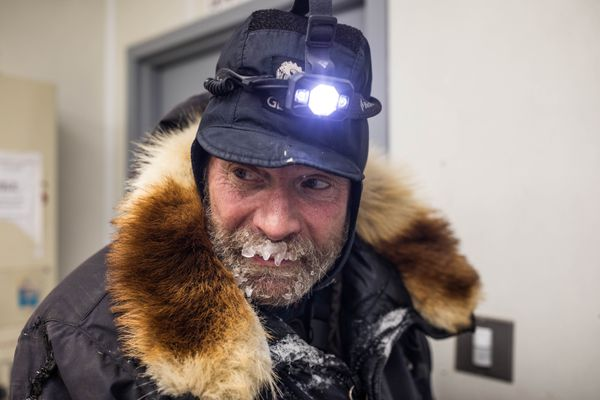 Jim Lanier gets hot water for his dogs Saturday, March 10, 2018 at the washeteria in Shageluk. (Loren Holmes / ADN)