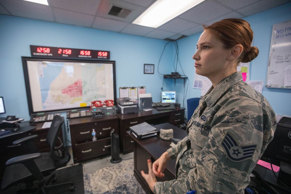 Staff Sgt. Samantha Glenny stands in the Joint Base Elmendorf-Richardson Base Ops building on Friday, Dec. 7, 2018. Glenny was the non-commissioned officer in charge when Friday's magnitude 7.0 earthquake struck, and she and her team worked quickly to inspect the airfield and establish communication with aircraft and the Anchorage airport, allowing planes to land and preparing for the potential that planes would be diverted from Anchorage to JBER. (Loren Holmes / ADN)