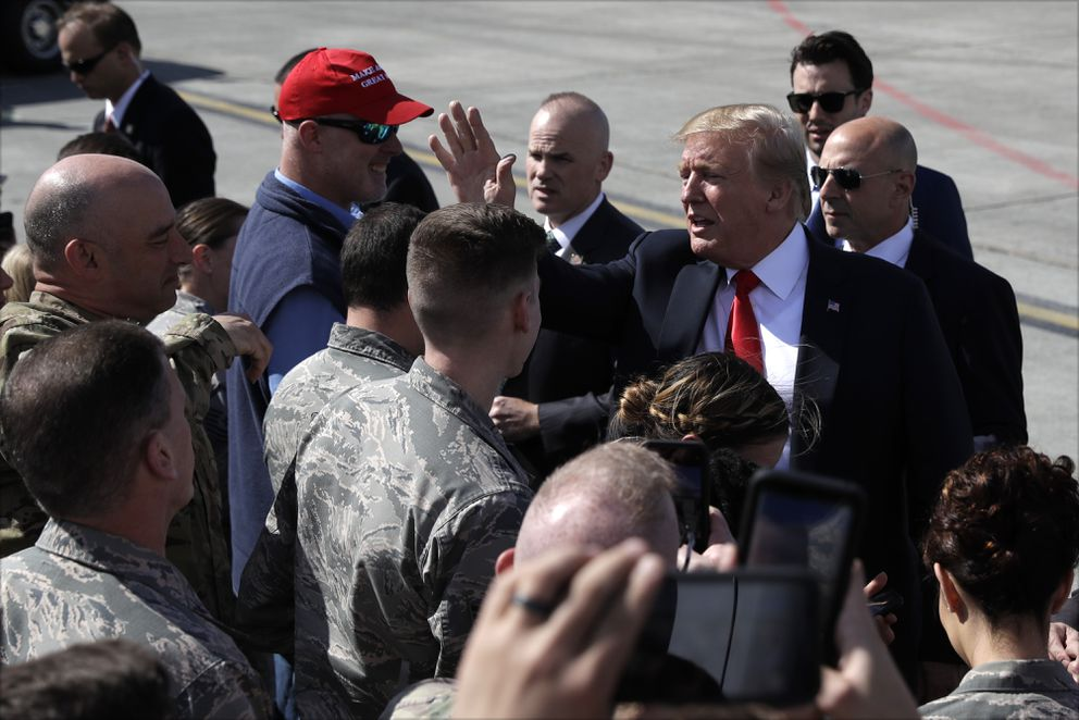 President Donald Trump greets troops after landing at Joint Base Elmendorf-Richardson for a refueling stop en route to Japan. (AP Photo/Evan Vucci)