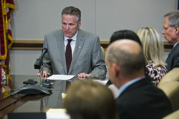 Gov. Mike Dunleavy talks and answers questions about his recent budget vetoes at the start of a meeting with members of his cabinet in Anchorage on July 15, 2019. (Marc Lester / ADN)