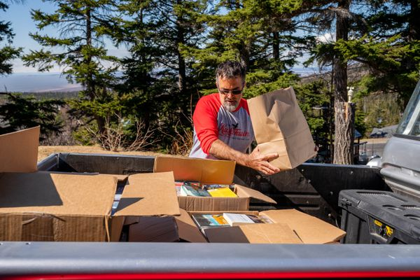 Don Rearden loads donated books into a truck at his home on Friday, May 7, 2021 in Bear Valley. The books will be sent to Anvil Mountain Correctional Facility in Nome. (Loren Holmes / ADN)