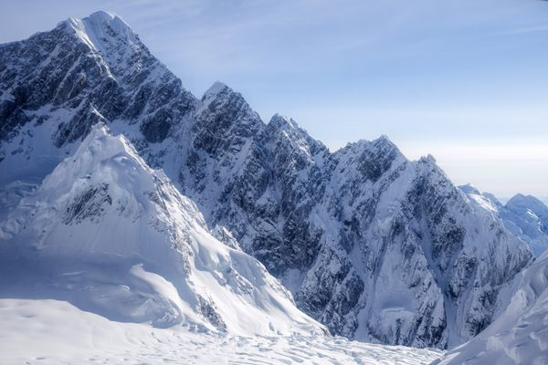 The South Ridge of Mount Huntington consists of a series of serrated peaks. The route gains approximately 9,000 feet of elevation en route to the summit, which sits at 12,240 feet. It was attempted by a Japanese team in 1978, but remained unclimbed until Jess Roskelley and Clint Helander accomplished the feat in April of 2017. (Clint Helander)