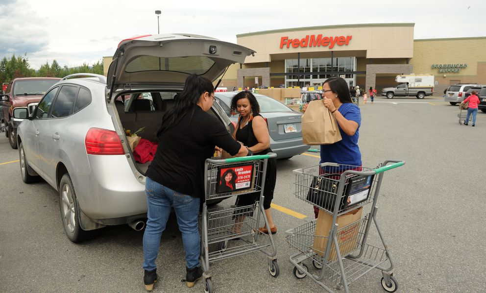 Jacynthia Oprenov, Michel Pantaleon and Marie Nickoli load groceries into the car at the Wasilla, AK Fred Meyer on Friday, July 13, 2018. Trio is in favor of the plastic bag ban. (Bob Hallinen / ADN)
