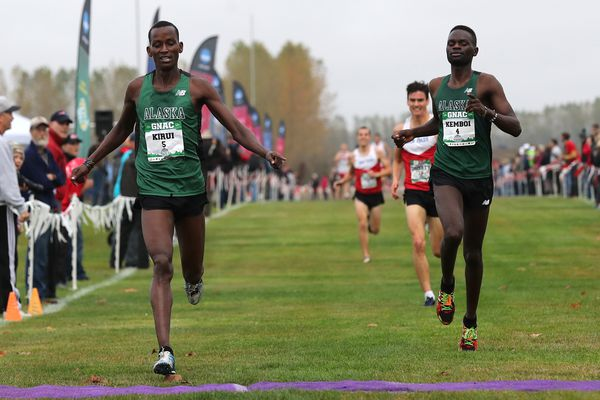 Wesley Kirui beats teammate Felix Kemboi by six-tenths of a second Saturday to give UAA a 1-2 finish in the men's race at the GNAC cross country championships in Monmouth, Oregon. (Photo by Jaime Valdez)
