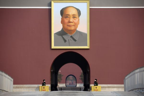 Chinese paramilitary police wear face masks as they stand guard beneath the large portrait of Chinese leader Mao Zedong at Tiananmen Gate adjacent to Tiananmen Square in Beijing, Monday, Jan. 27, 2020. China on Monday expanded sweeping efforts to contain a viral disease by postponing the end of this week's Lunar New Year holiday to keep the public at home and avoid spreading infection. (AP Photo/Mark Schiefelbein)