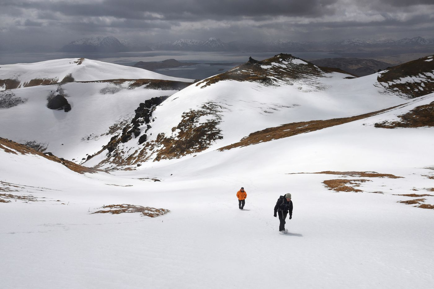 Cale Green and Michael Dickerson climbing 2,001-foot Mount Adagdak, on the northern tip of Adak Island. Photographed April 30, 2019. (Paxson Woelber)