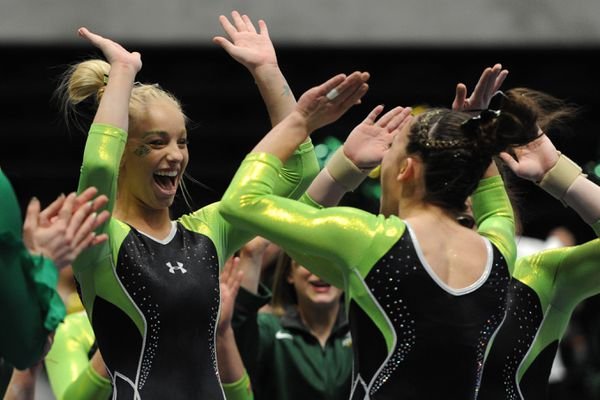 UAA gymnast Hope Nelson congratulates Tere Alonso after she competed on the beam UAA during the Seawolves' 191.175 to 188.900 home victory over Brown at the Alaska Airlines Center on Sunday, Jan. 13, 2019. (Bill Roth/ ADN)