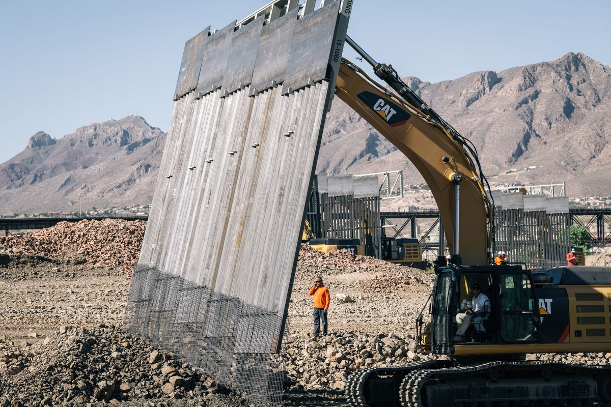 Fisher Industries workers drop a piece of wall into place on May 24, 2019, in Sunland Park, N.M., on private land near where New Mexico, Texas and Mexico come together. (Photos for The Washington Post by Jordyn Rozensky and Justin Hamel)