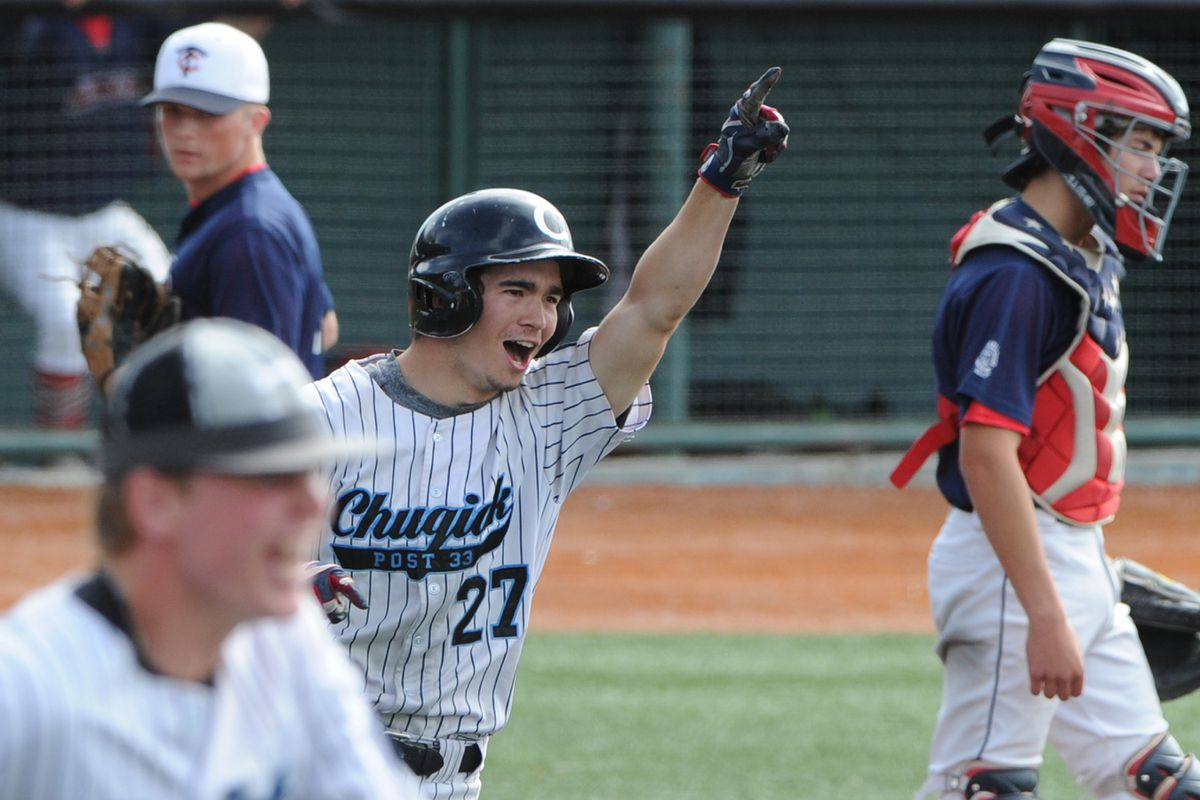 Justin Nevells celebrates after scoring the winning run on Connor Lanehart's walkoff single in Chugiak's 4-3 victory over the Kenai Twins in the state tournament Sunday at Mulcahy Stadium. (Bill Roth / ADN)