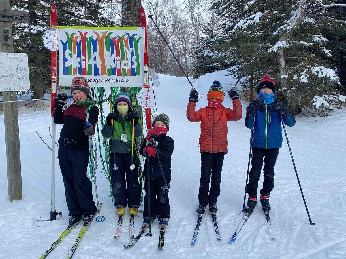 From left, Reinzi Witmer, Suvan Schwoerer, Kai Schwoerer, Ethan Elliott, and Riley Elliott gather for the week-long Ski 4 Kids at Kincaid Park. The event lasts through Saturday afternoon at Kincaid Park. (Photo by Beth Elliott)