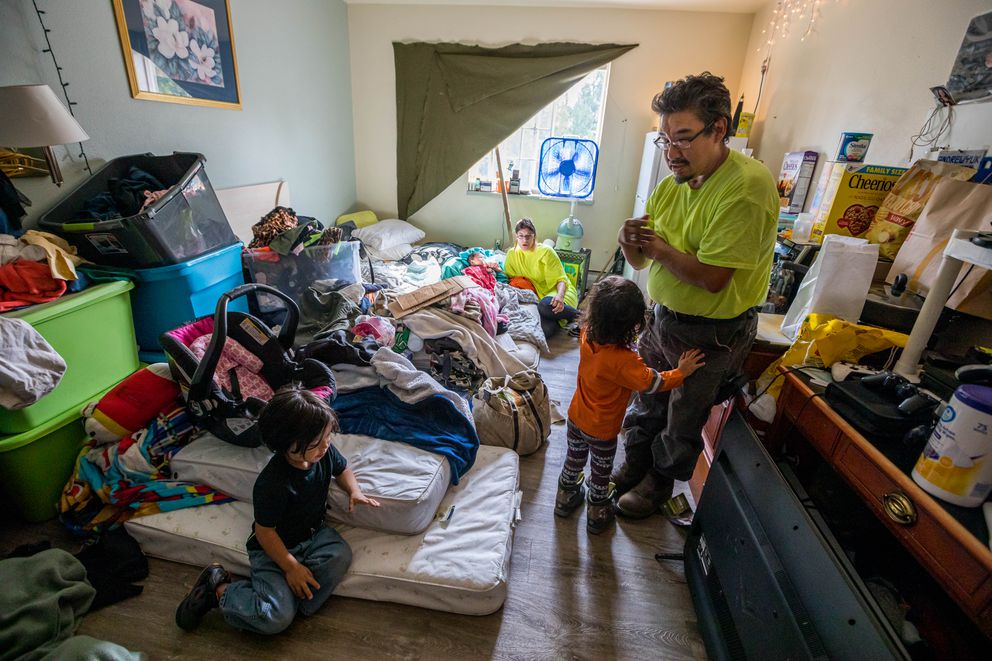 Galen G. Huntsman and Arianne Swihart with their three children, Azriel Huntsman, 4, Galen T. Huntsman, 3, and Aurora Huntsman, 2 months, in a studio apartment they rent at Safe Harbor in Muldoon on Thursday, July 18, 2019. The family signed a lease in late April and pay $550 per month. 'Now we can start rebuilding our family, ' said Galen, who was granted custody of his older children in early July. Previously the family was living with Arianne's grandmother in a room smaller than their studio. The family has been following the state budget issues and is concerned for the future of their housing situation, which is supported with state money that was vetoed by Gov. Mike Dunleavy. 'I feel like I'm having the carpet pulled out from underneath me, ' said Galen. (Loren Holmes / ADN)