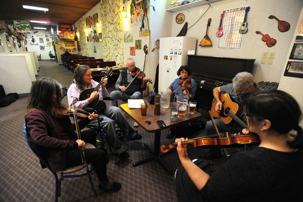 From left Jan Myers, Sherri Hadley, Claude Brouillette, Debbie Addie, and Gary and Rosemarie Fitch turn out forthe weekly Old Time Jam on Thursday at Guido's Pizza. (Erik Hill / Alaska Dispatch News)