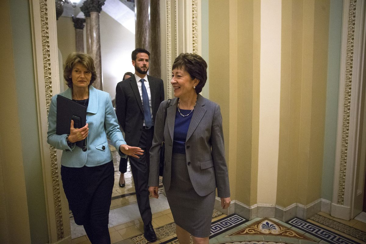 FILE — Sens. Susan Collins, R-Maine, right, and Lisa Murkowski, R-Alaska, on Capitol Hill in Washington, Feb. 23, 2016. (Doug Mills/The New York Times)