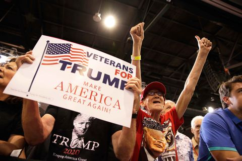 Supporters of U.S. President Donald Trump cheer before his arrival at a campaign rally in Phoenix, Arizona, U.S., August 22, 2017. REUTERS/Joshua Roberts