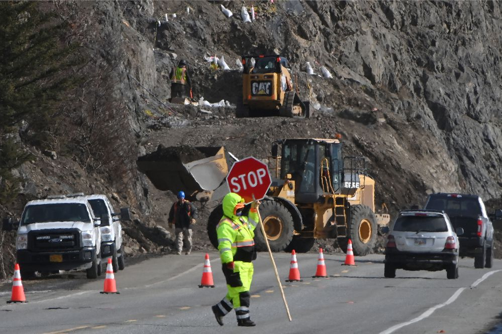 Workers prepare a site for blasting operations at milepost 111.5 of the Seward Highway, just south of McHugh Creek, on Tuesday, March 23, 2021. The highway will be closed between milepost 110 and 112 from 11 p.m. on Tuesday, March 23 to 3 a.m. on Wednesday, March 24. State DOT&PF and a contractor are performing stabilization work to mitigate rockfall sites along the Seward Highway between Anchorage and Girdwood. The project is expected to be complete in July 2023. (Bill Roth / ADN)