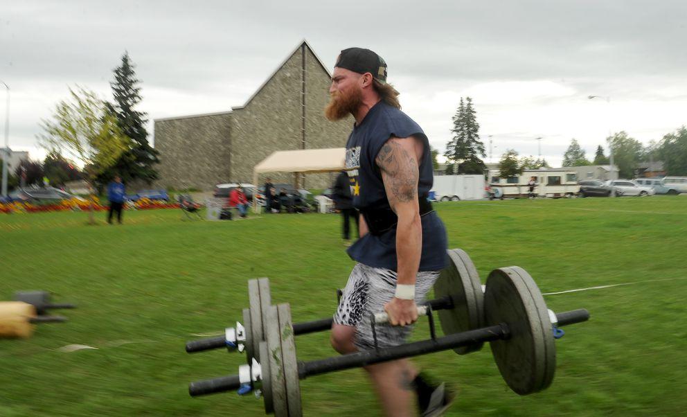 Brian Peeler competes in the Farmer's Walk. (Bob Hallinen / Alaska Dispatch News)