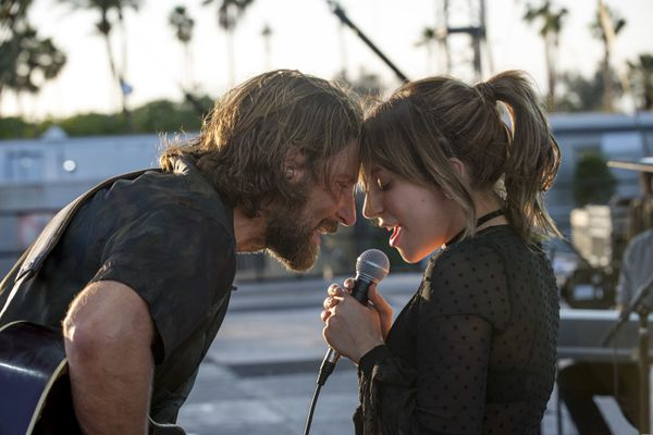 This image released by Warner Bros. shows Bradley Cooper, left, and Lady Gaga in a scene from the latest reboot of the film,