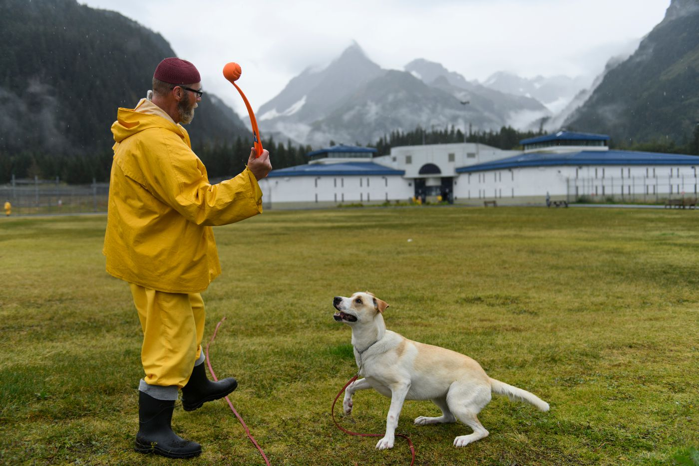 John Blalock works on obedience training with a dog named Sura in the Spring Creek prison yard on Sept. 27, 2018. The prison's Shelter Pet Obedience Training (SPOT) program helps prepare dogs for adoption. (Marc Lester / ADN)