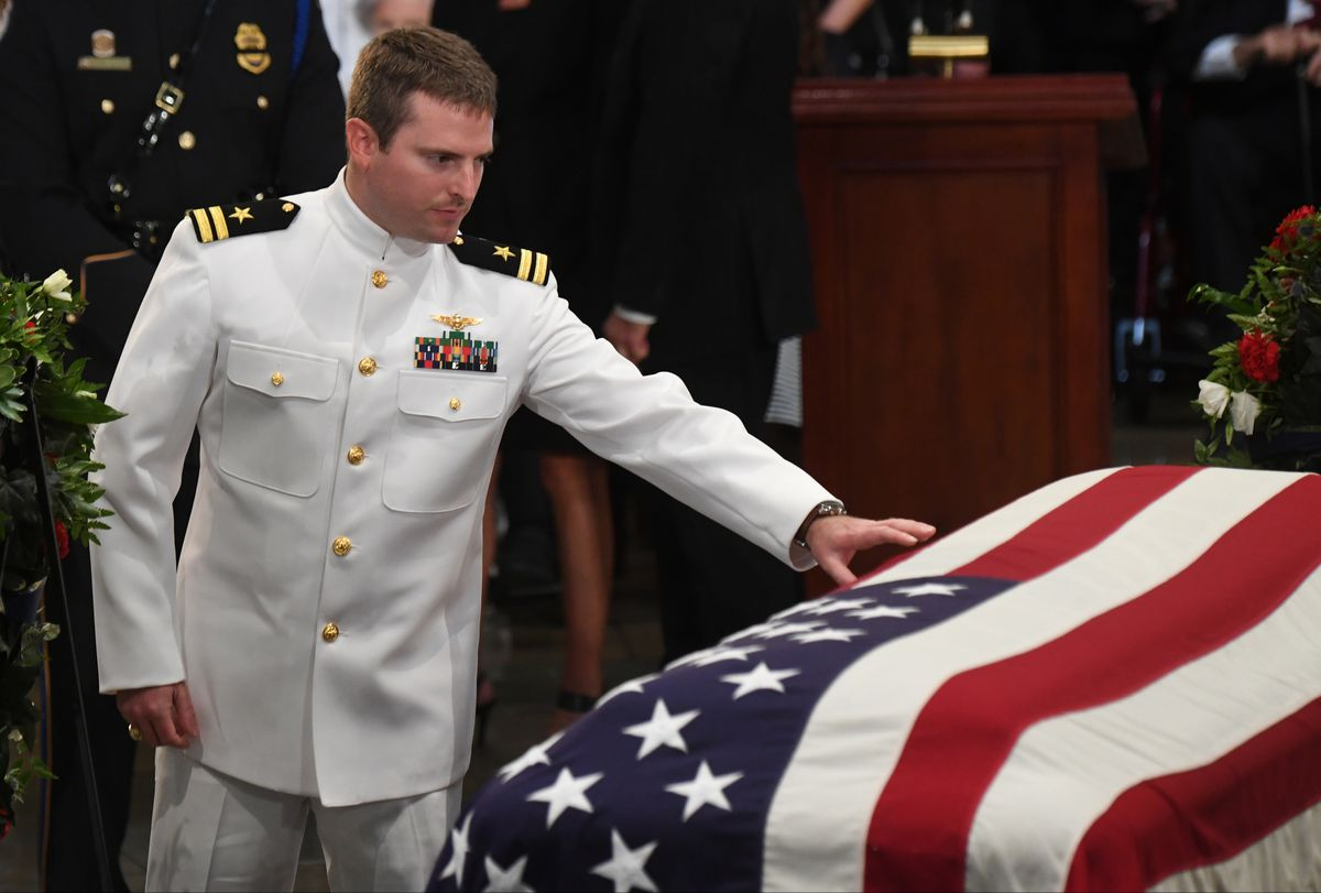 Jack McCain touches his father's casket in the Capitol Rotunda last August. (Washington Post photo by Jonathan Newton)