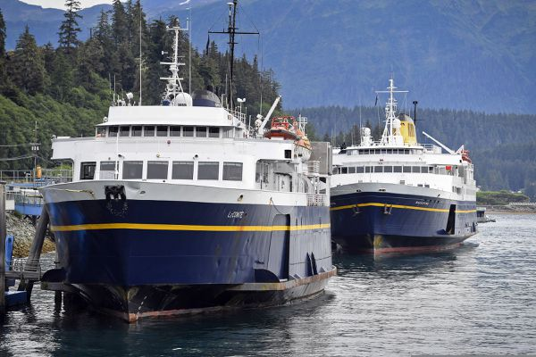 The Alaska Marine Highway System ferries LeConte, left, and Malaspina are tied up at the Auke Bay Terminal on Thursday, July 25, 2019. The Inland Boatmen's Union of the Pacific called a strike on Wednesday over failed negotiations with Gov. Mike Dunleavy's administration. State officials said Thursday more than $580,000 in fares has been refunded to passengers affected by striking ferry workers. (Michael Penn/The Juneau Empire via AP)