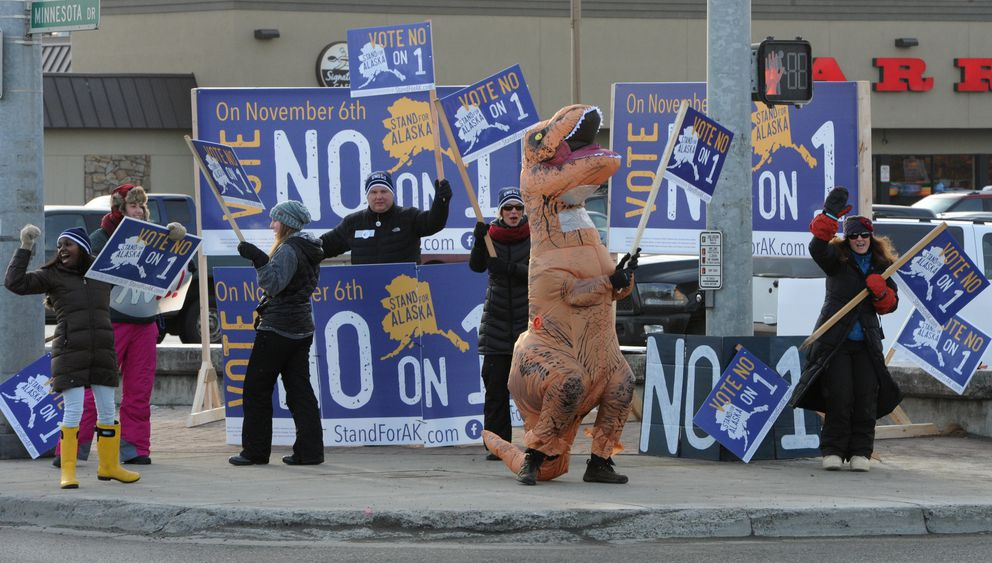 Stand for Alaska supporters wave signs on Election Day, Tuesday, Nov. 6, 2018. (Bill Roth / ADN)