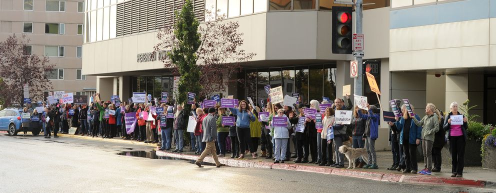 Over one hundred people gathered in front of US Senator Lisa Murkowski's office on L Street in downtown, AK to protest the nomination of Brett Kavanaugh to US Supreme Court on Friday, September 28, 2018. (Bob Hallinen / ADN)
