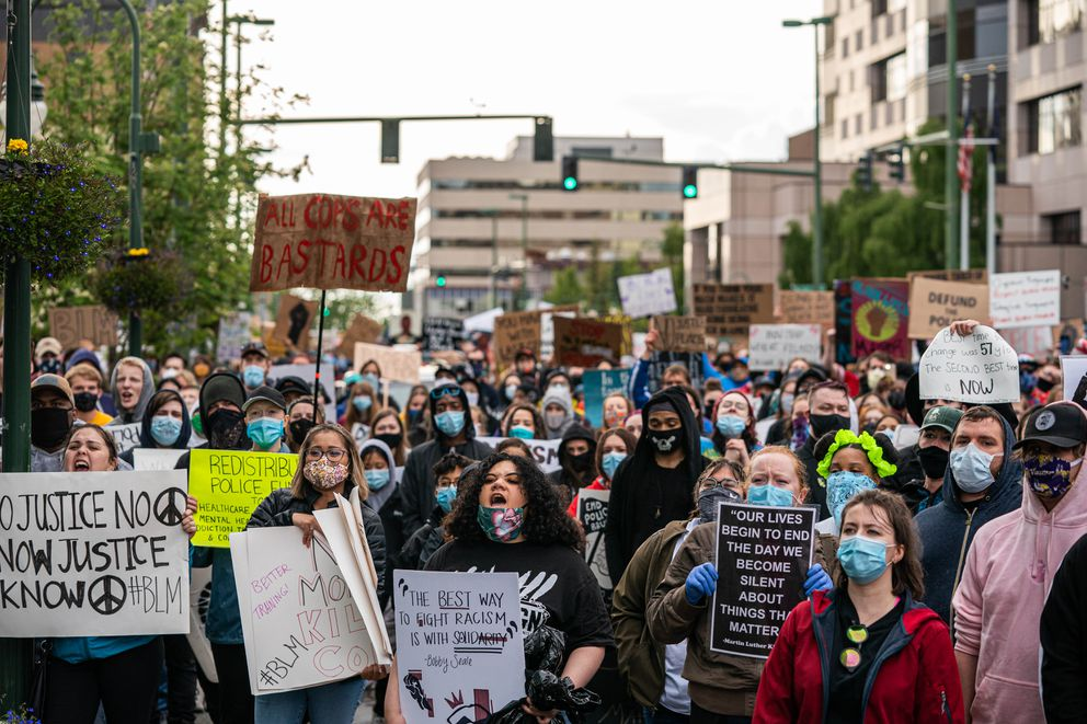 A large crowd protests in front of the Anchorage Police Department headquarters on Saturday. (Loren Holmes / ADN)