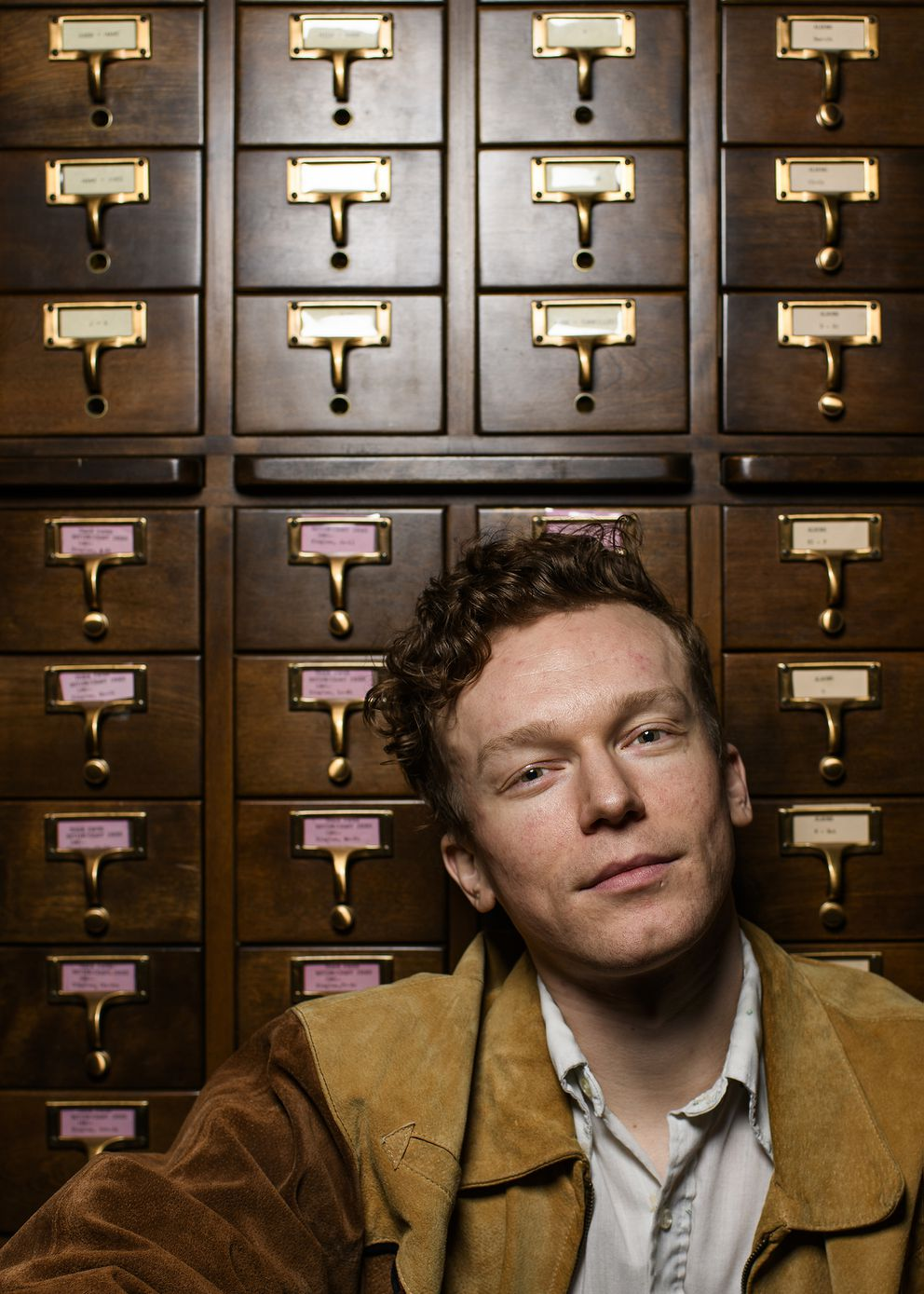 Tyler Mahan Coe of the country music podcast 'Cocaine and Rhinestones ' in front of a card catalogue in the archives of the Country Music Hall of Fame in Nashville. Photo for The Washington Post by William DeShazer