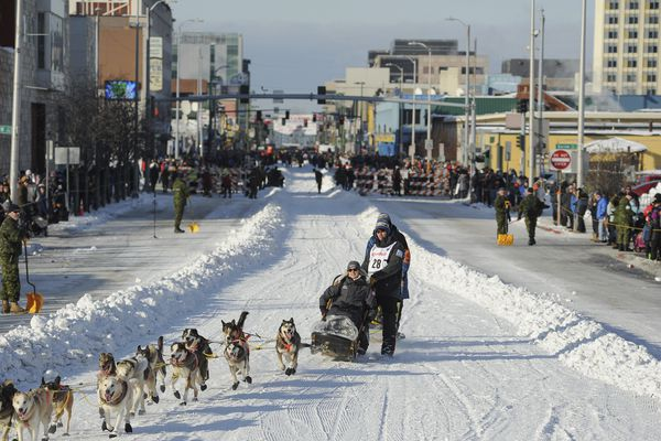 FILE - In this March 2, 2019, file photo, defending champion Joar Lefseth Ulsom runs his team down Fourth Ave during the ceremonial start of the Iditarod Trail Sled Dog Race in Anchorage, Alaska. When 57 mushers line up Sunday, March 8, 2020 for the official start of the Iditarod Trail Sled Dog Race, it will be the second-smallest field in the past two decades. (AP Photo/Michael Dinneen, File)
