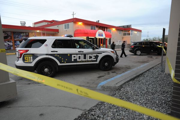 Anchorage police investigate a shooting in the 600 block of East Fifth Avenue late Wednesday, May 16, 2018. Two people were wounded, and a suspect was in custody, police said. (Bill Roth / ADN)