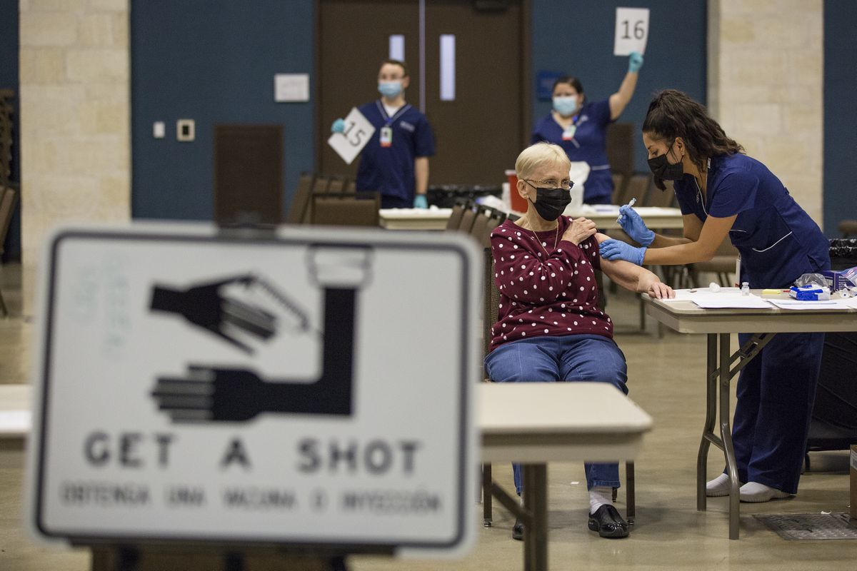 FILE - In this Jan. 21, 2021, file photo, Edna Becker receives the Moderna coronavirus vaccine from nurse Patricia Torres at the mass vaccination clinic at the New Braunfels Civic/Convention Center in New Braunfels, Texas. As the nation's COVID-19 vaccination campaign accelerates, governors, public health directors and committees advising them are holding key discussions behind closed doors, including debates about who should be eligible for the shots and how to best distribute them. (Mikala Compton/Herald-Zeitung via AP, File)