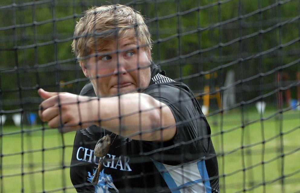 Chugiak's Kenny Huffer throws the discus. (Matt Tunseth / Chugiak-Eagle River Star)