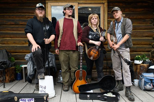 Musicians, from left, Carley Conemac, Ryan Black, Garrett Moe and Dillon Gamby formed the music group Fishslap Oar Die weeks ago after gathering for seasonal work in Homer. Photographed on June 19, 2018. (Marc Lester / ADN)