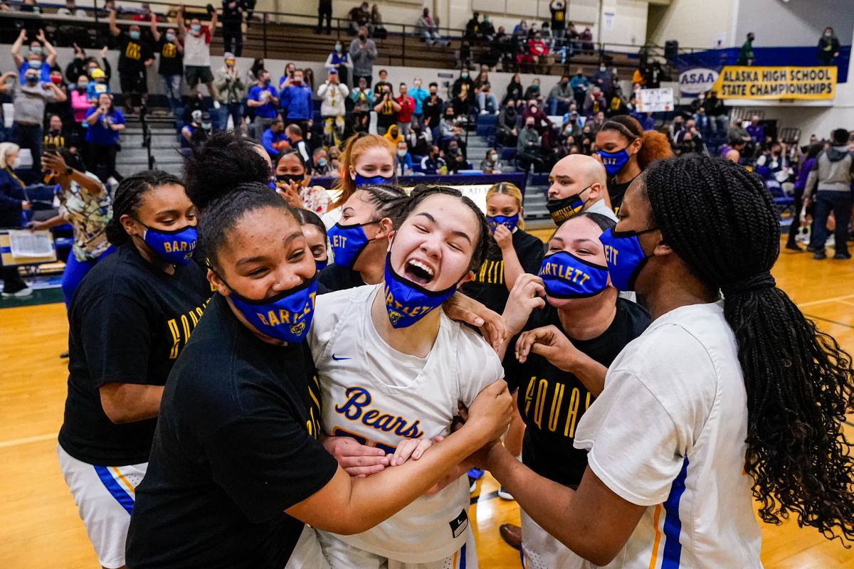 The Bartlett girls basketball team celebrate their overtime victory in the Class 4A state championship game Saturday night. (Loren Holmes / ADN)