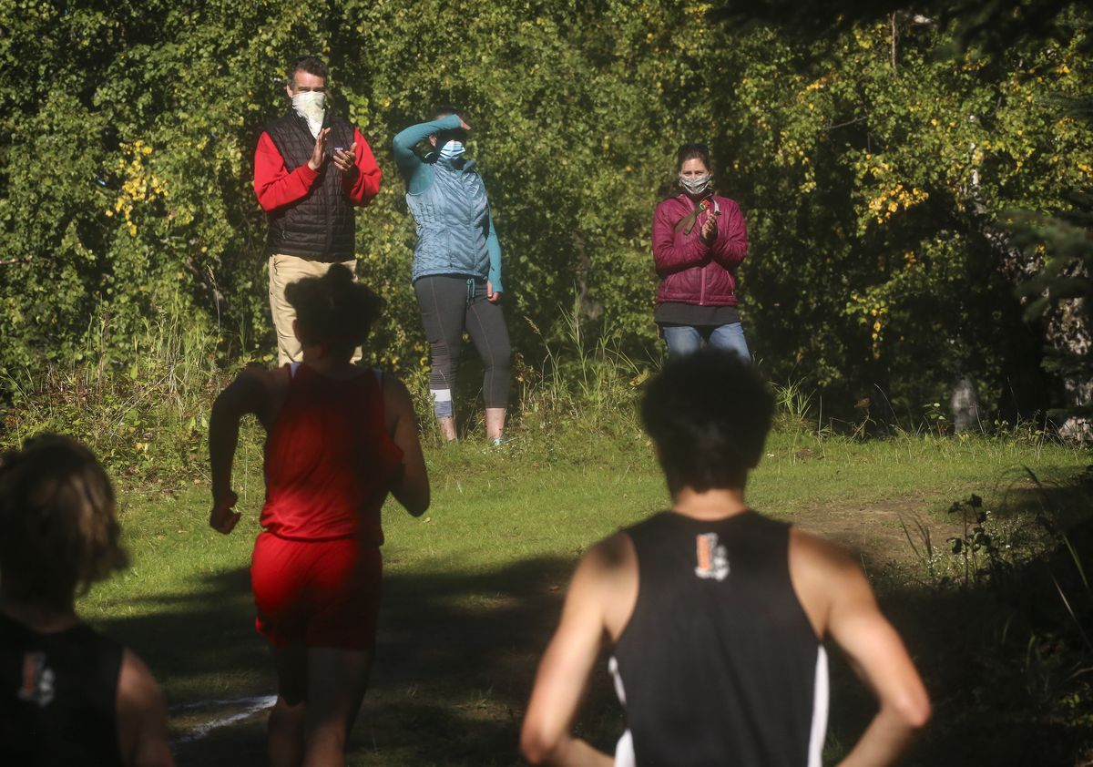 Spectators in masks encourage runners on the Kincaid Park cross country trails Saturday. (Emily Mesner / ADN)