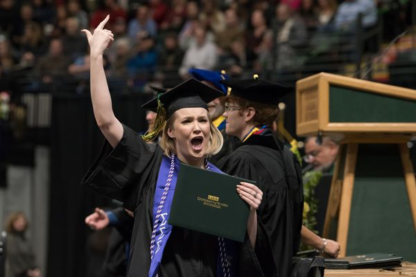 Jamie Logan, B.A. Sociology, receives her degree during UAA's Fall 2018 Commencement Ceremony at the Alaska Airlines Center. (Photo by James Evans / UAA)