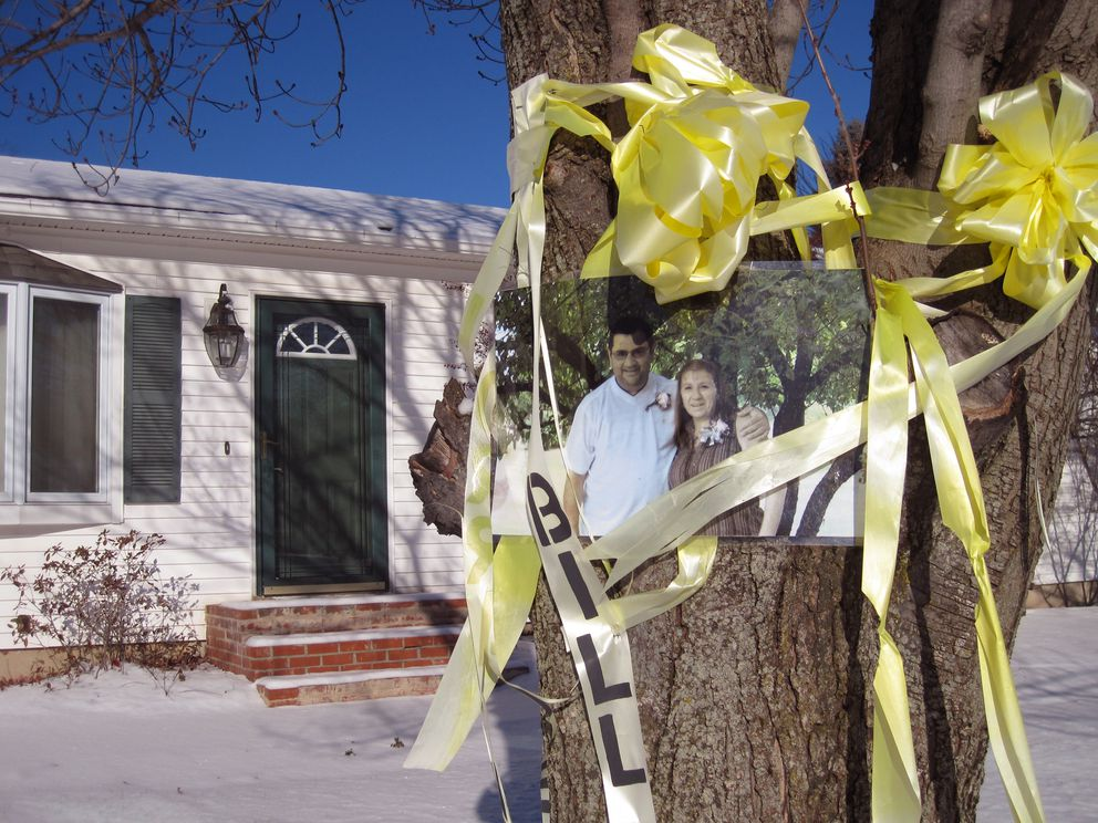 A photo of Bill and Lorraine Currier along with a yellow ribbon is displayed on a tree on the couple's front lawn Dec. 29, 2011, in Essex, Vt. Israel Keyes confessed to killing the Curriers. (Matt Ryan / Burlington Free Press)