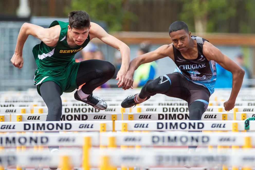 Service's Jacob Jines, left, and Chugiak's Jeremiah Wilson compete in the 110 meter hurdles during the CIC championships Saturday, May 18, 2019 at Dimond High. (Loren Holmes / ADN)