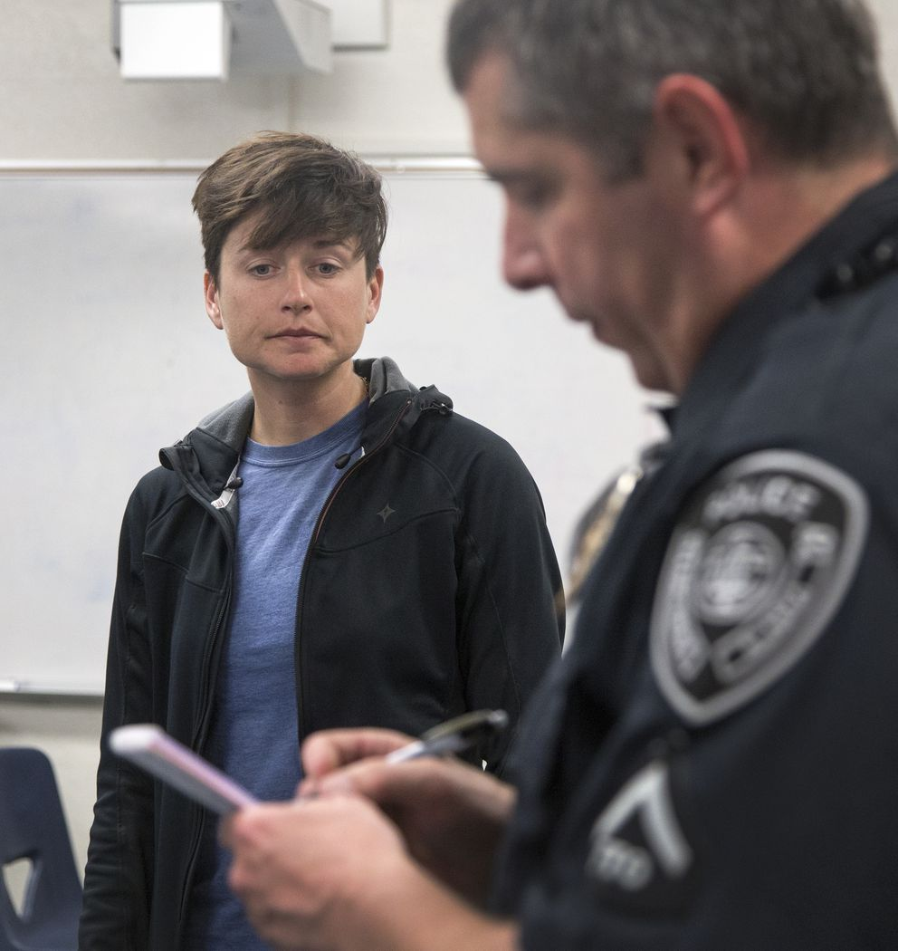 Lael Wilcox files a report for the stolen bicycles with Officer Baker at Steller Secondary School on Monday. The bicycles were kept in an outdoor classroom and there were no signs of forced entry into the building. Security cameras captured footage of the bikes being stolen. (Rugile Kaladyte / Alaska Dispatch News)