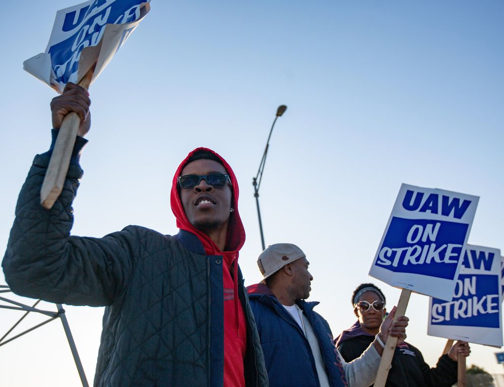 Motorline worker Ray Gladney of Florrisant, materials worker Brookes Robinson of Central West End, and Trim Doorline Worker Danielle Harris of Richmond Heights, picket at the General Motors plant in Wentzville, Mo., on Tuesday, Oct. 22, 2019. (Troy Stolt/St. Louis Post-Dispatch via AP)