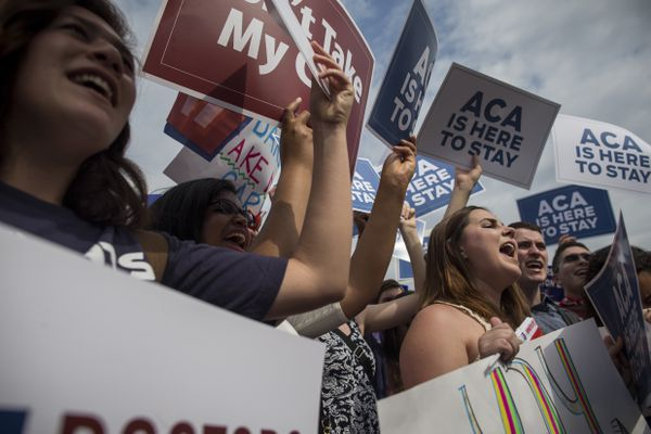 FILE — Demonstrators cheer after hearing that justices had upheld the Affordable Care Act, outside the Supreme Court building in Washington, June 25, 2015. Stabilizing the market, lowering drug prices and expanding access to coverage would go a long way to easing millions of Americans' concerns about health care. (Zach Gibson/The New York Times)