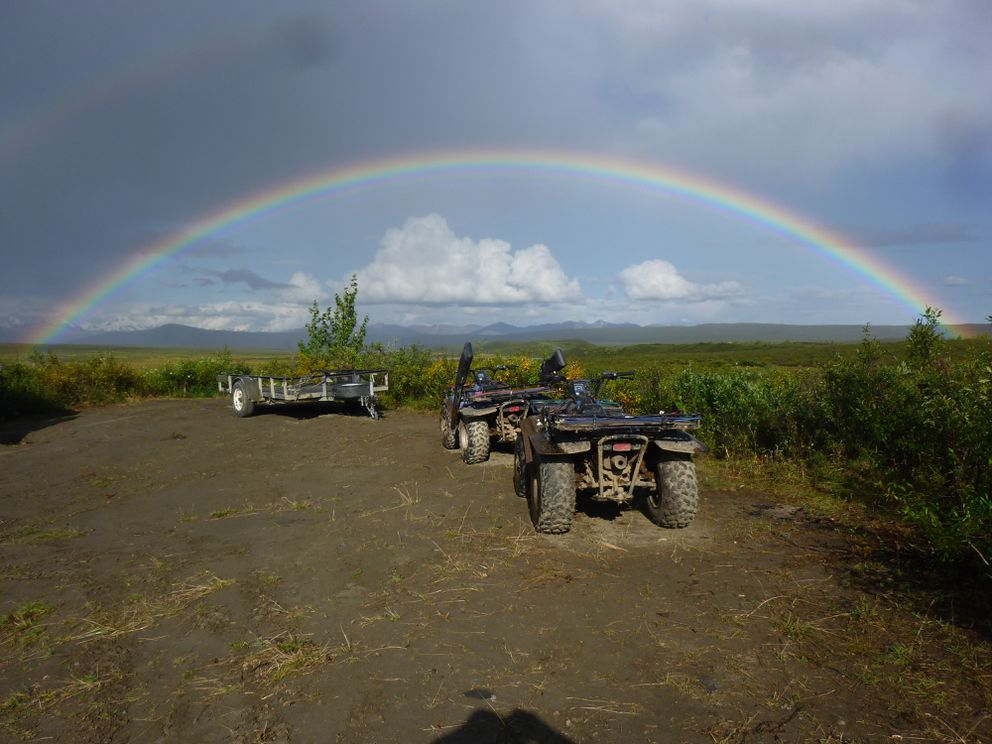 A rainbow frames four-wheelers during an early September caribou hunt off the Denali Highway. This past weekend, the last of the moose season, more than 100 rigs were parked at the Swede Lake trailhead. Virtually all of these hunters were riding ATVs. (Rick Sinnott)