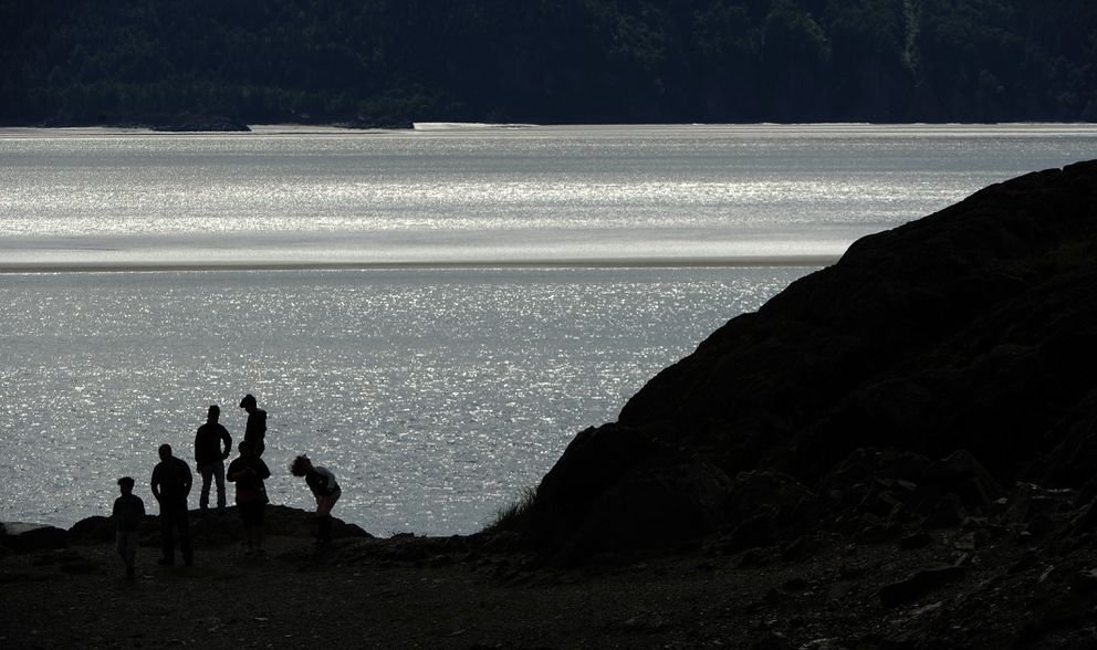 People check out Turnagain Arm at Beluga Point along the Seward Highway as the sunlight sparkles off the water on Thursday, August 9, 2018. (Bob Hallinen / ADN)