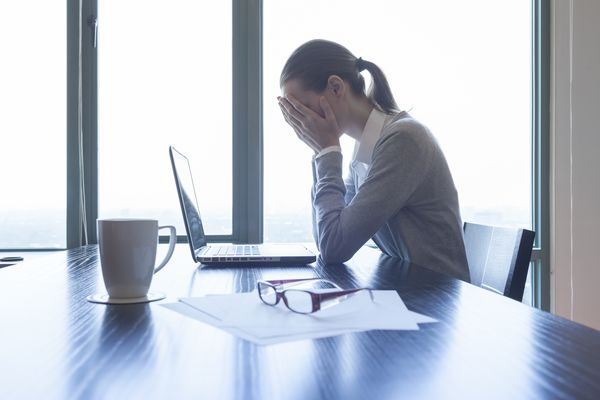 Stressed businesswoman in the office. (Thinkstock)