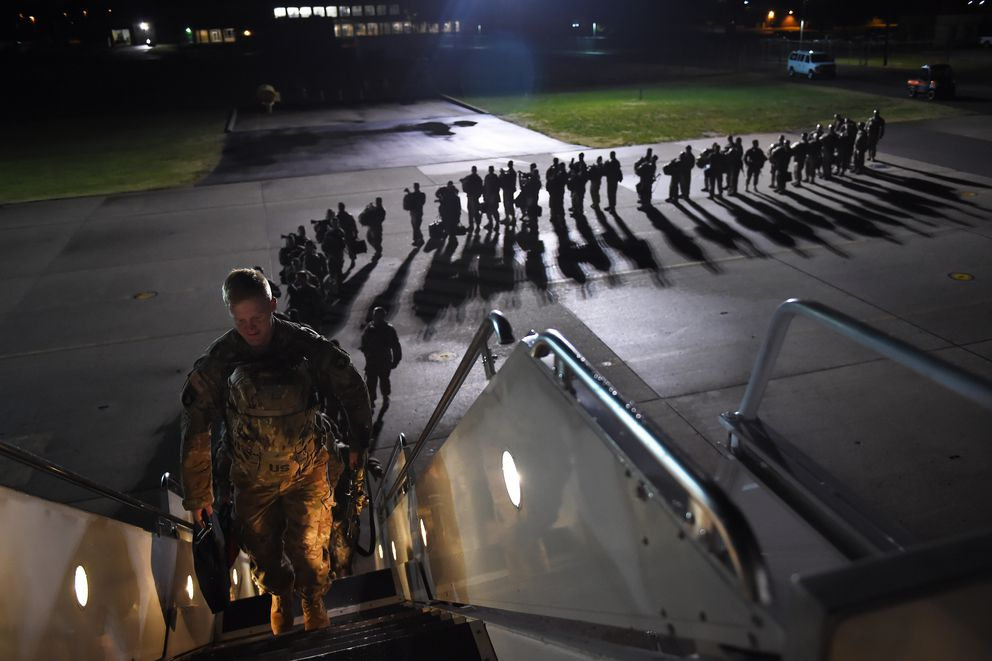 U.S. Army personnel board a plane for a deployment to Afghanistan from Fort Campbell, Ky., on Nov. 6, 2014. (Washington Post photo by Matt McClain)